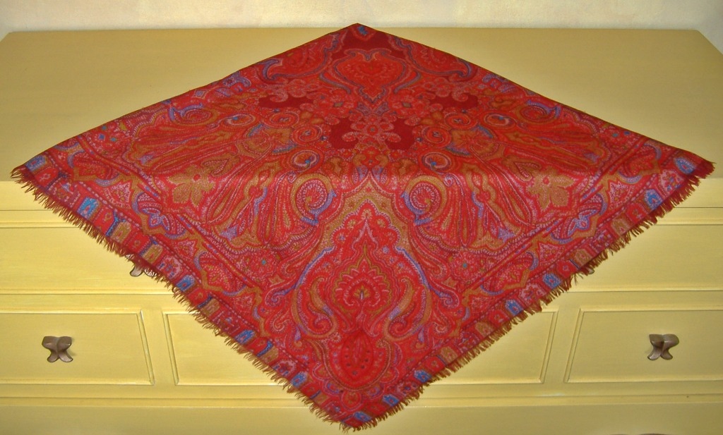 The colors of this largely red Provençal shawl and its royal blue and gold accents remain vibrant after many years of use.
