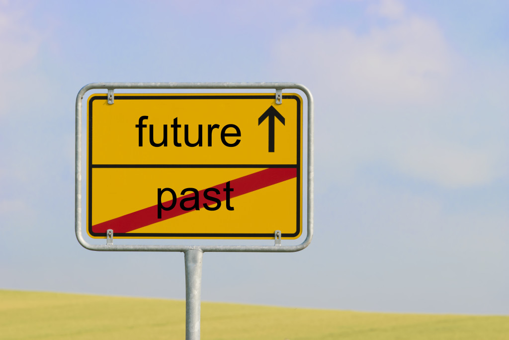 Never let your past limit your future. Sign past future by Wolfgang Zwanzger.