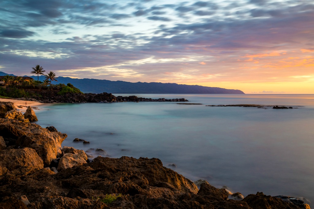 This beach in Haleiwa, Hawaii at sunset is one gorgeous place to have a quiet travel adventure. Image: Haleiwa by Christian Joudrey.