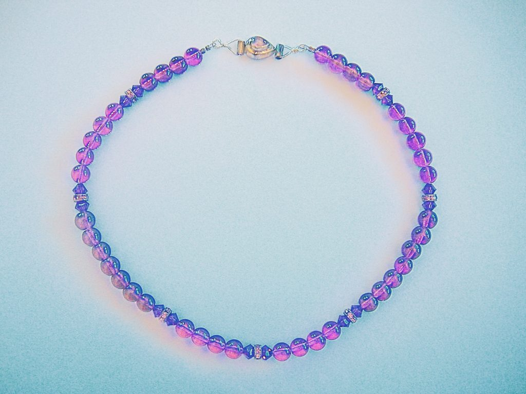 Beaded necklace of Murano glass and Swarovski elements designed by T.E., a woman created to create beautiful things.