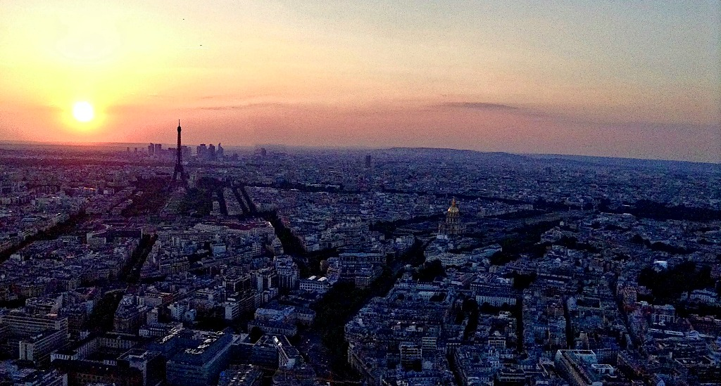 Don't miss this sunset view from Tour Montparnasse on your solo trip to Paris.
