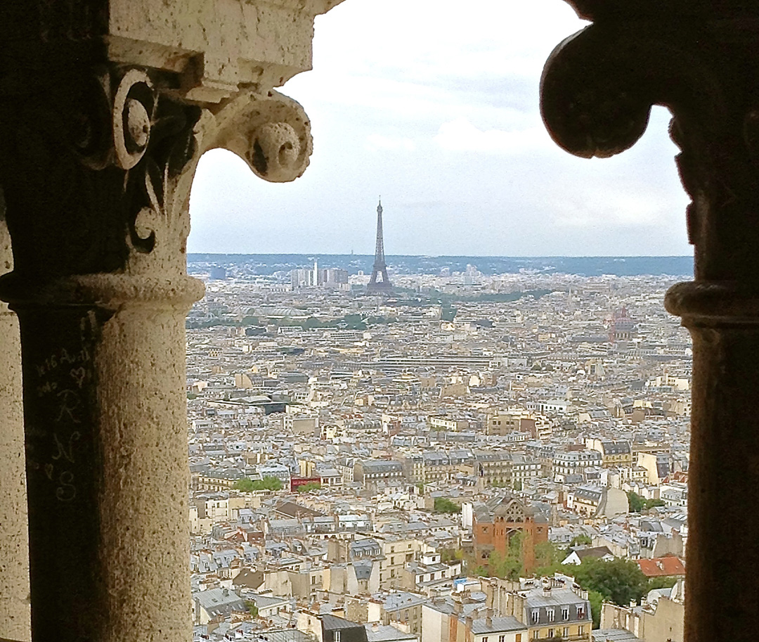 Enjoy this view of the Eiffel Tower from Sacre Coeur on your solo trip to Paris.