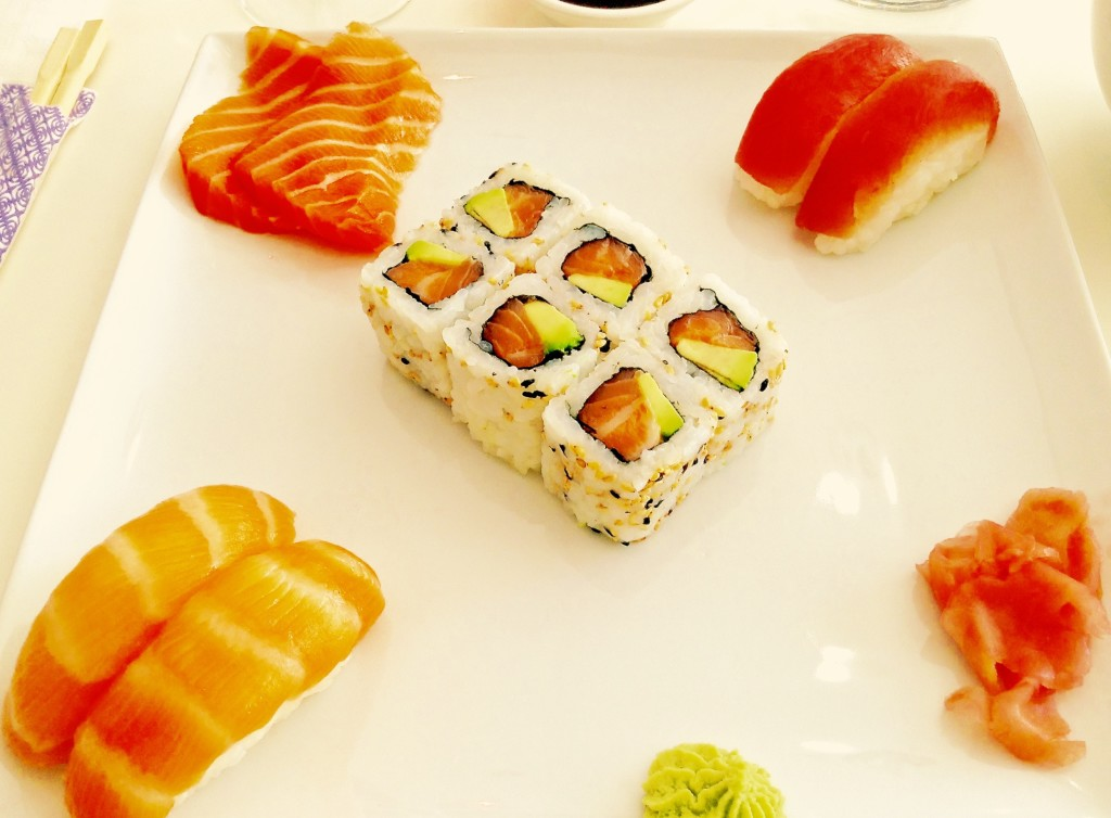 Oh, yes, you can find good sushi in the Chihuahuan Desert! Image: Sushi & sashimi on square white plate.