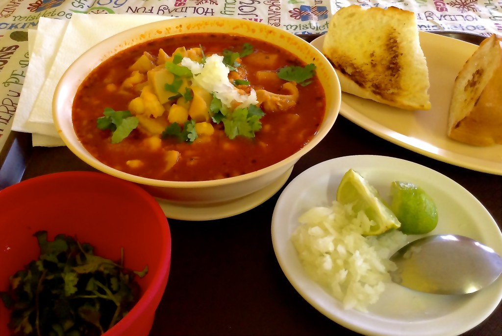 Menudo at Bravo's with bread and garnishes.