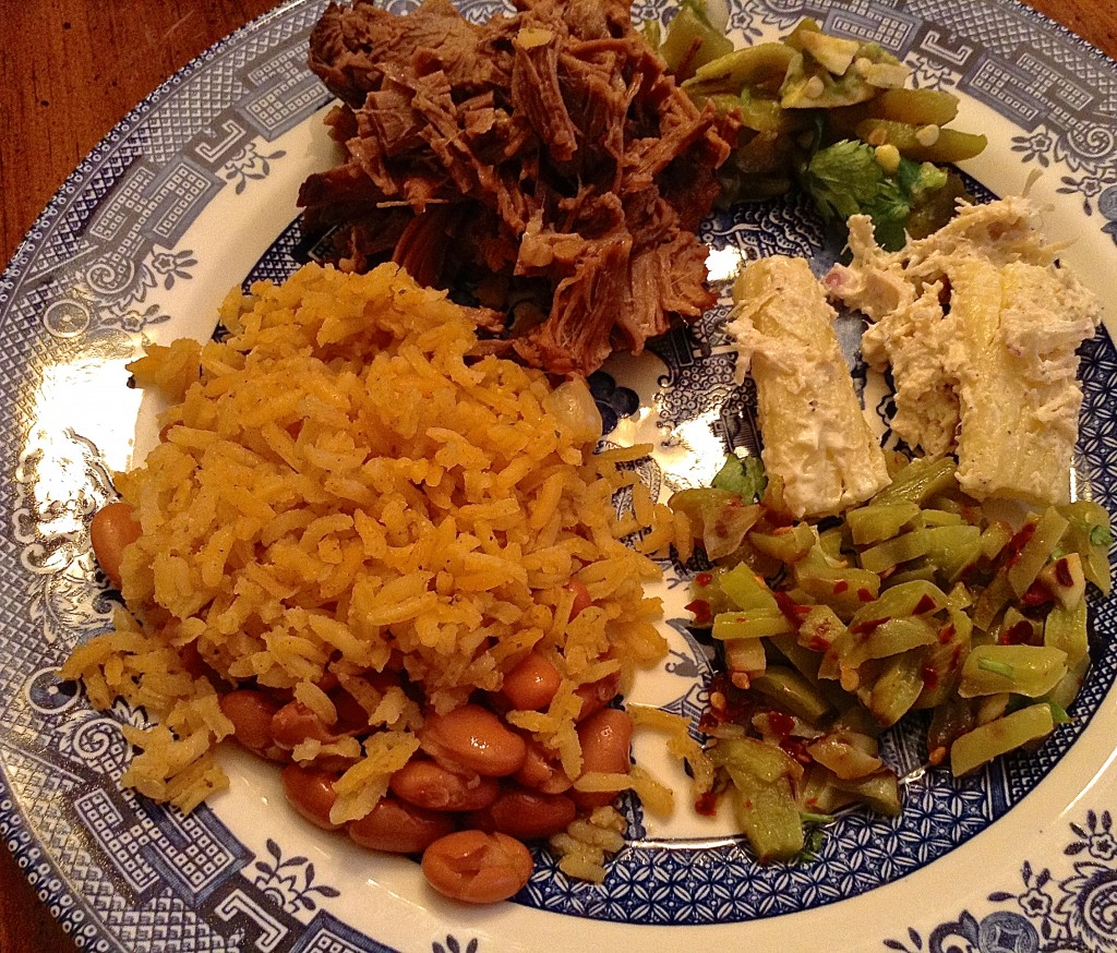 Dinner plate with brisket, rice and beans, and nopalitos, cactus on your plate.