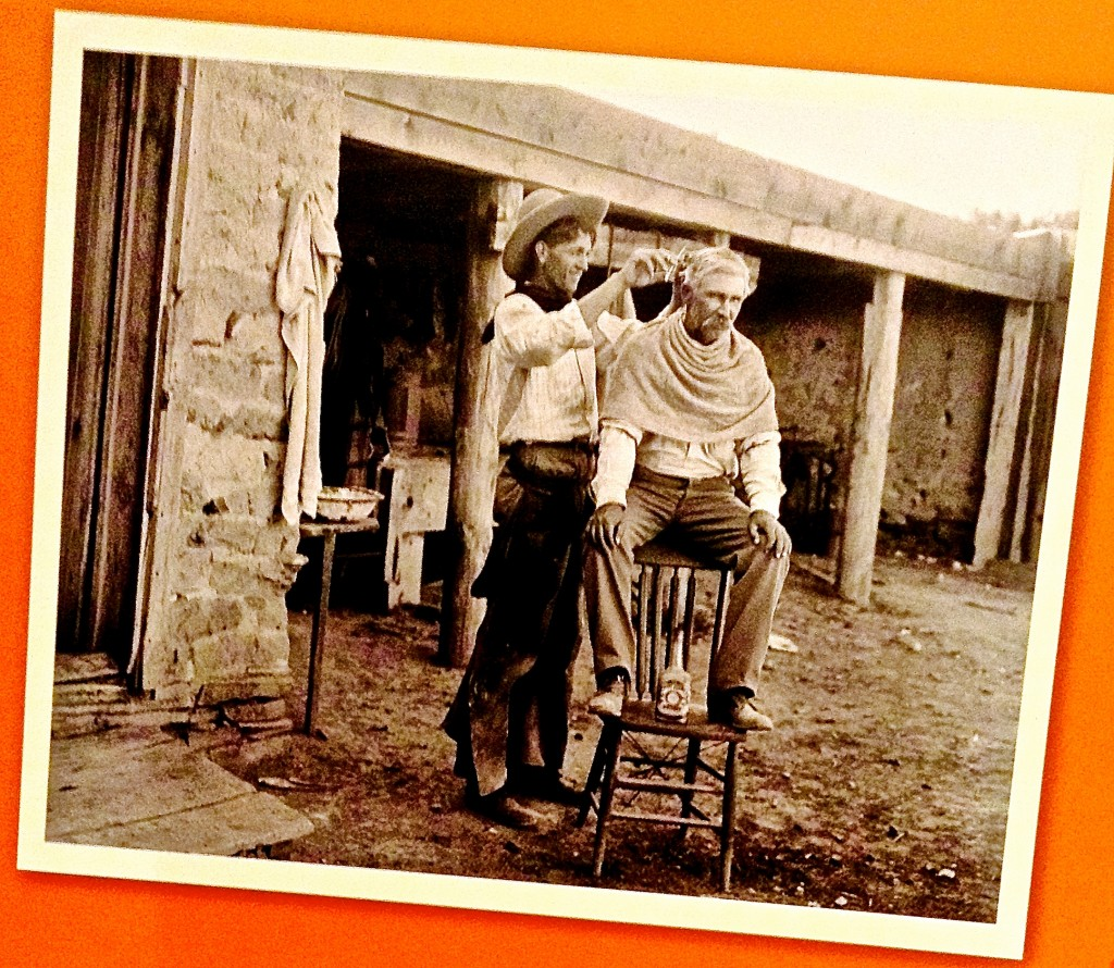 Hair Cut at the Bar W Ranch ~  a scene from New Mexico's cultural past shown at the New Mexico Farm and Ranch Heritage Museum in Las Cruces.