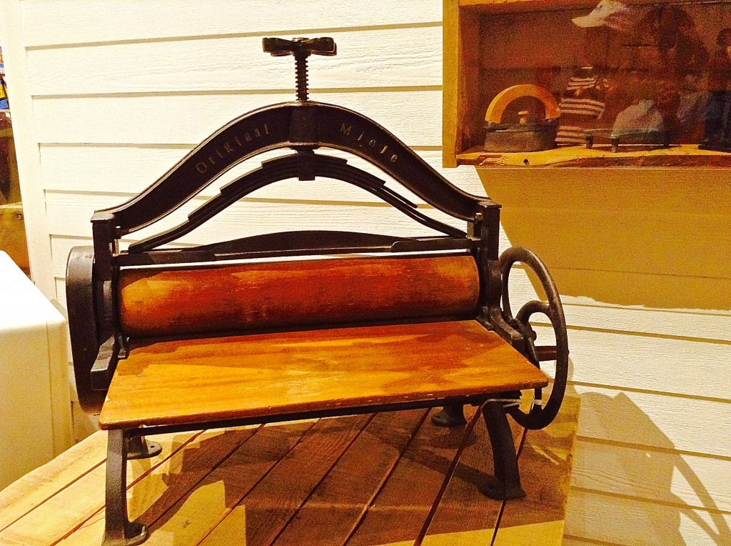 Antique mangle machine by Miele, household appliance from New Mexico's cultural past.