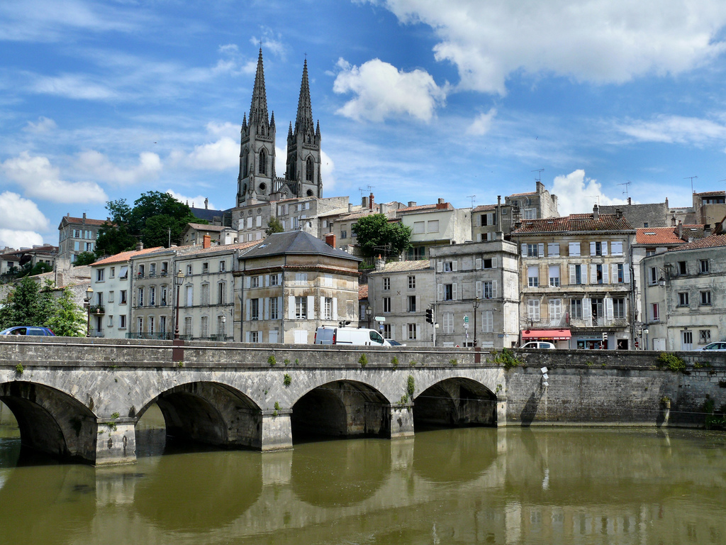 You'll see many beautiful riverside cities on your French pastry tour. Niort (in Poitou-Charentes, France) by dynamosquito@Flickr.