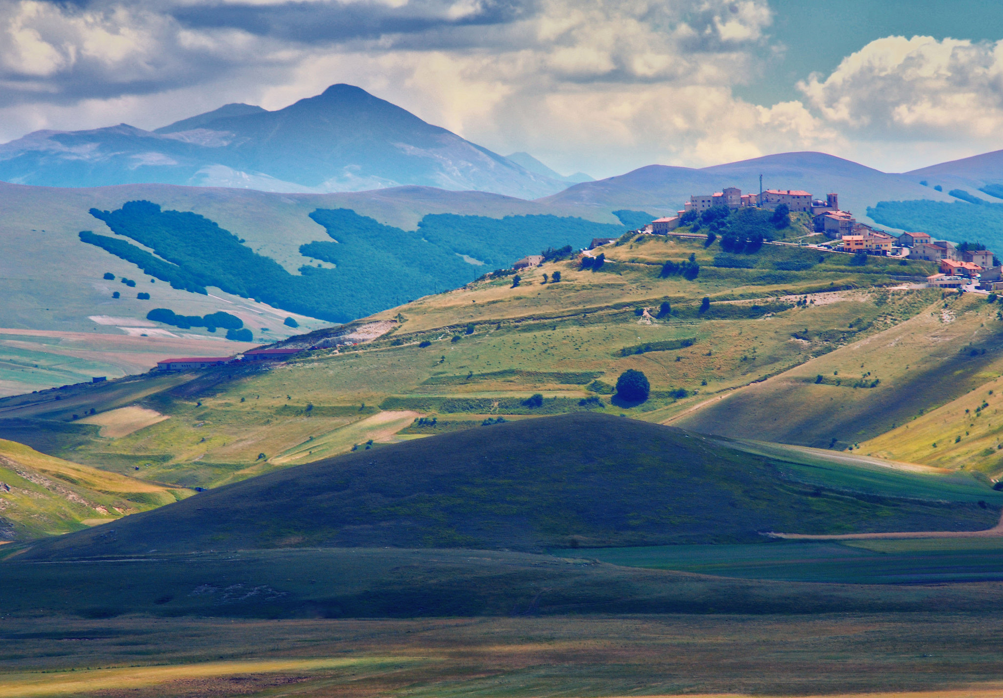 The Central Italian hills are alive with Italian sweets. ;) Castelluccio di Norcia, Umbria, Italy by Eric Huybrechts.