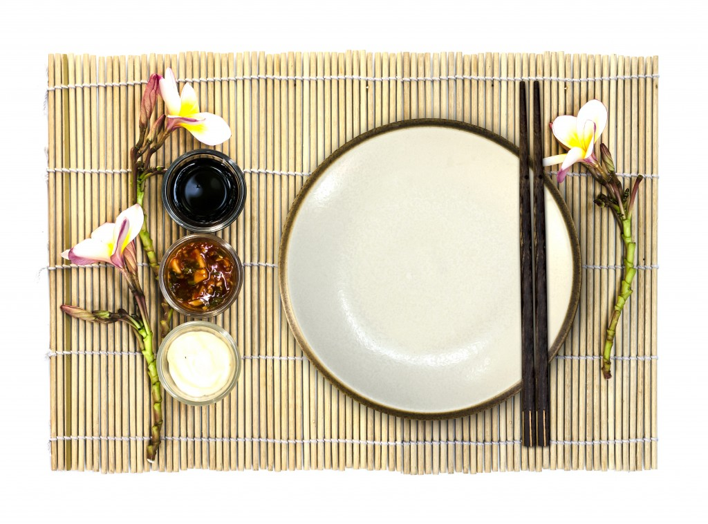 Empty plate with hashi (chopsticks) and condiments by ohsuriya.