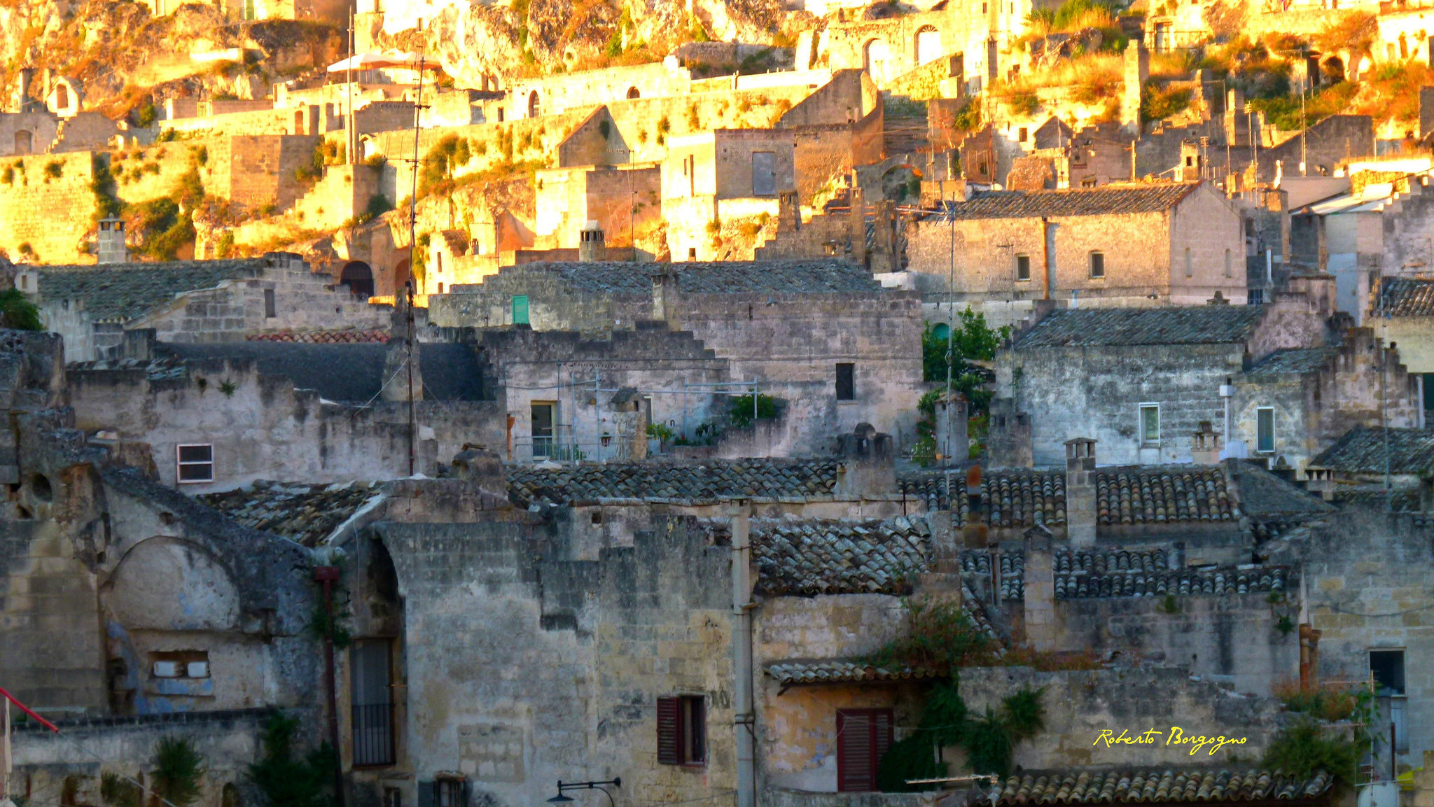 After sampling a dish of Southern Italian sweets, take a walking tour of the nearby sights.L'alba sui sassi di Matera (Dawn on Matera's OldTown) by BORGHY52.