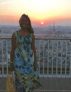 Atop Tour Montparnasse at sunset with the Eiffel Tower on my solo trip to Paris.
