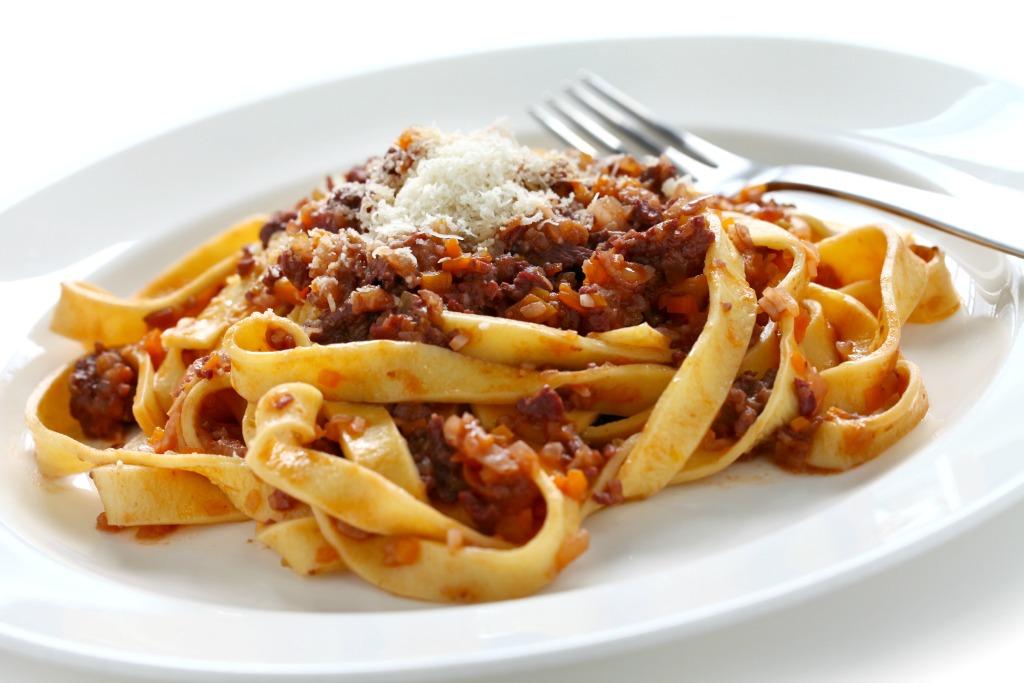 Tagliatelle con Ragù Bolognese, Italy's national dish, originates in Emilia-Romagna. Image: Tagliatelle with ragù bolognese by uckyo.