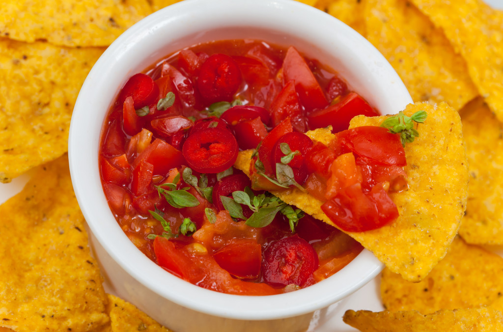 Tortilla chip with chilli salsa by meteo021; look for a great tasting salsa in one of today's links you'll like.