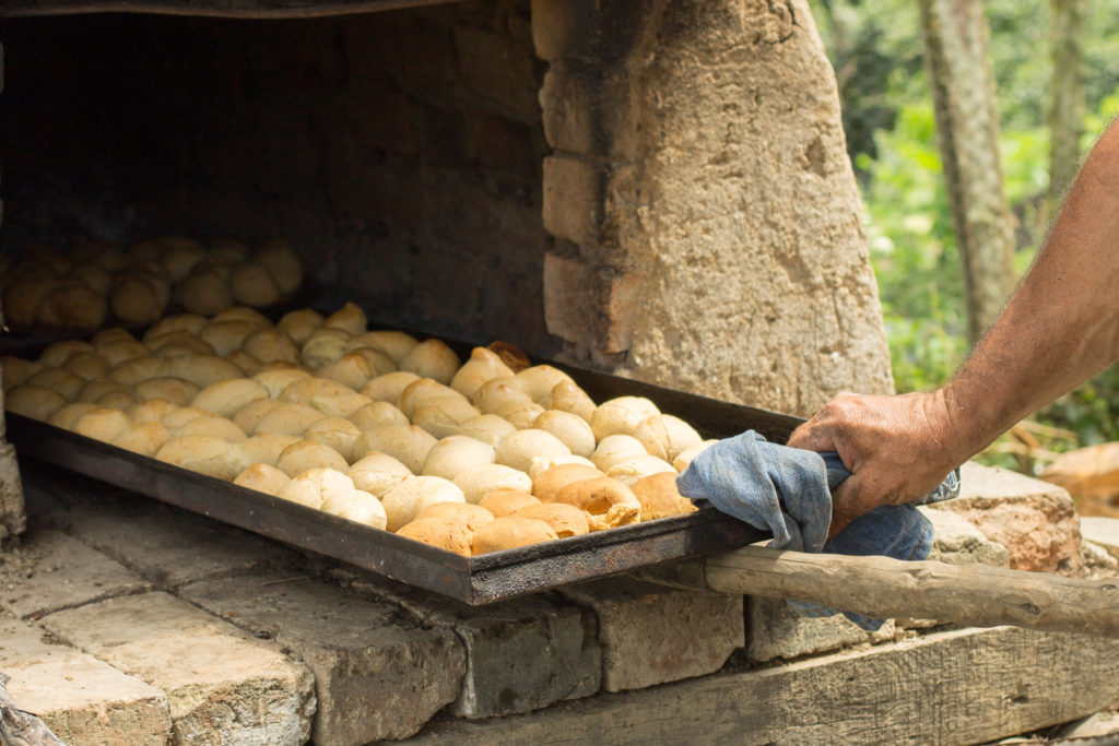 A great New Mexico travel experience means fresh baked bread; horneando by German Mosquera.