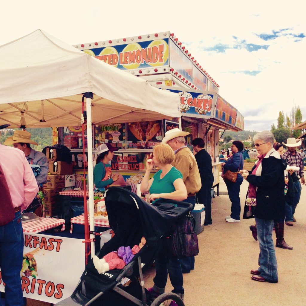 Caramel apple slices and deep-fried funnel cakes are among the sweets you can eat at this Lincoln County cowboy festival.