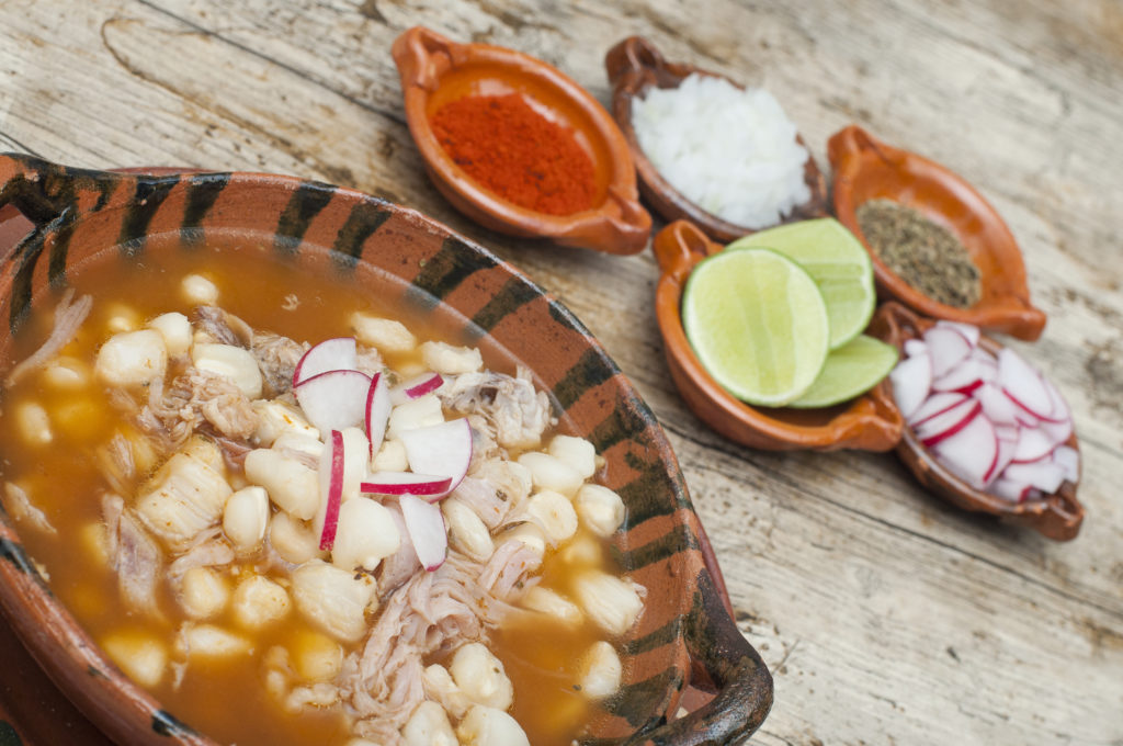 Include a hot bowl of pozole ~ a hominy stew ~ in your wintertime Southwest travel plans; image of Pozole Rojo is by leonardomarcel.