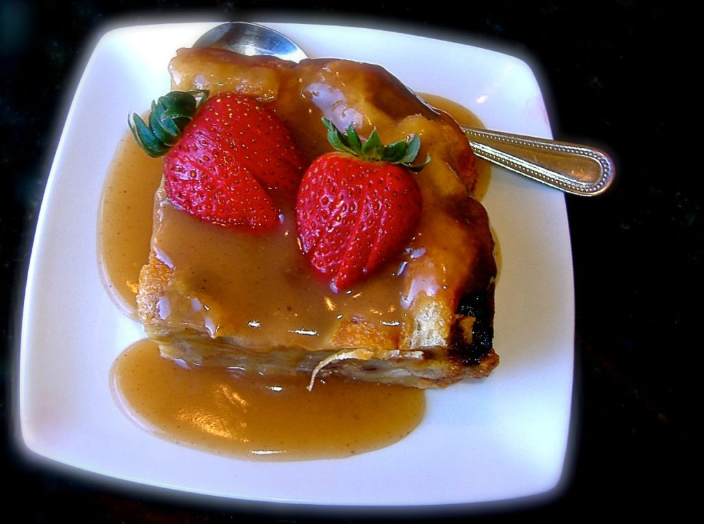Two strawberries atop a square of Praline Bread Pudding, St. Clair Winery & Bistro, Las Cruces, New Mexico.