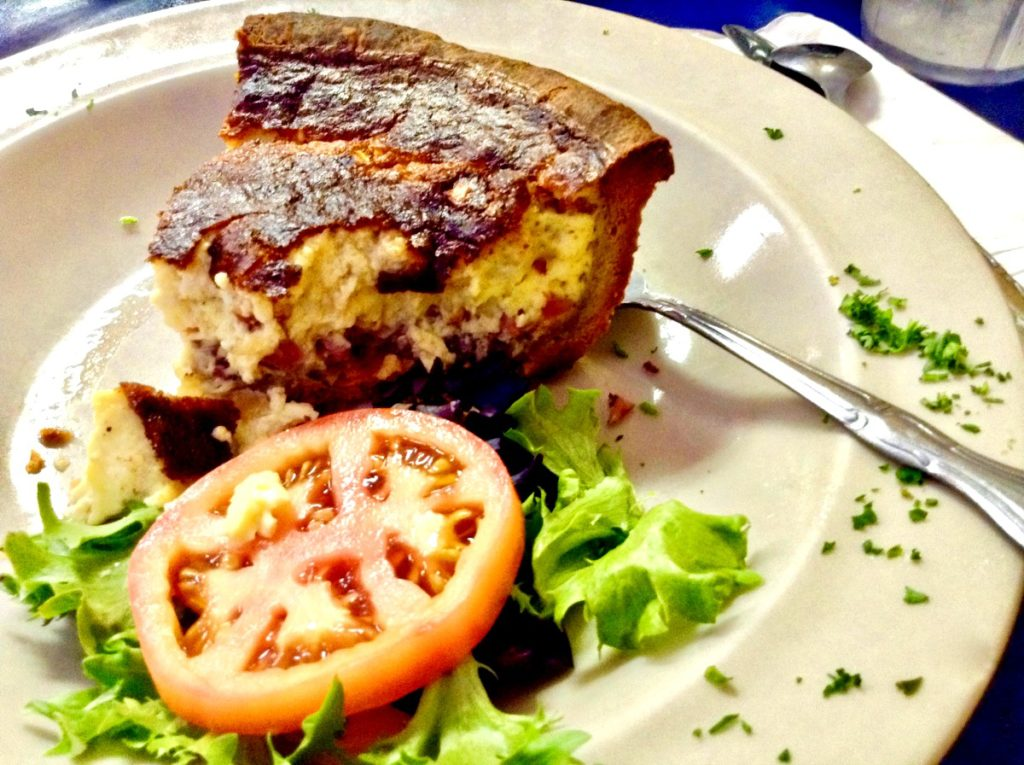 A tall FAT slice of le Rendezvous Cafe Quiche Lorraine with salad; find it in Las Cruces, NM.