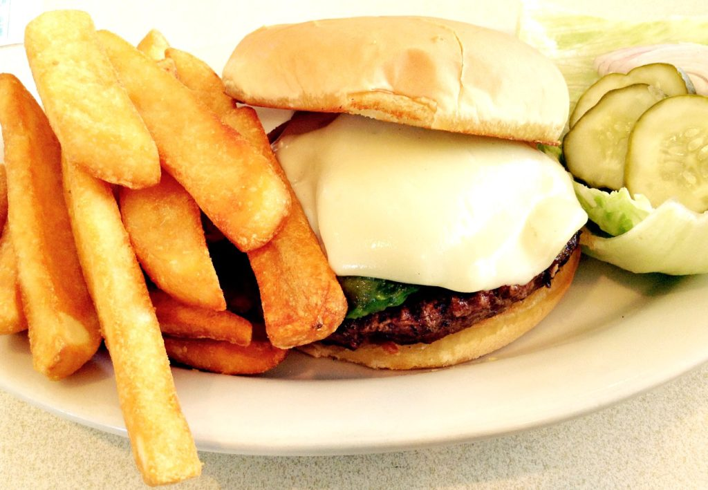 The Pecos River Cheeseburger, at Pecos River Cafe in Carlsbad, NM ~ way west of the Texas frontier country ~ is not one of the best green chile cheeseburgers New Mexico has to offer.