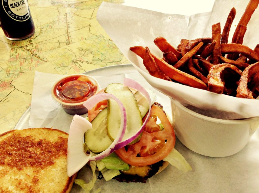 """The Good Ole Reliable burger, here with """"sweet fries,"""" is one of the variety of sandwiches you can get at delicious Big D's Downtown Dive in Roswell, NM."""