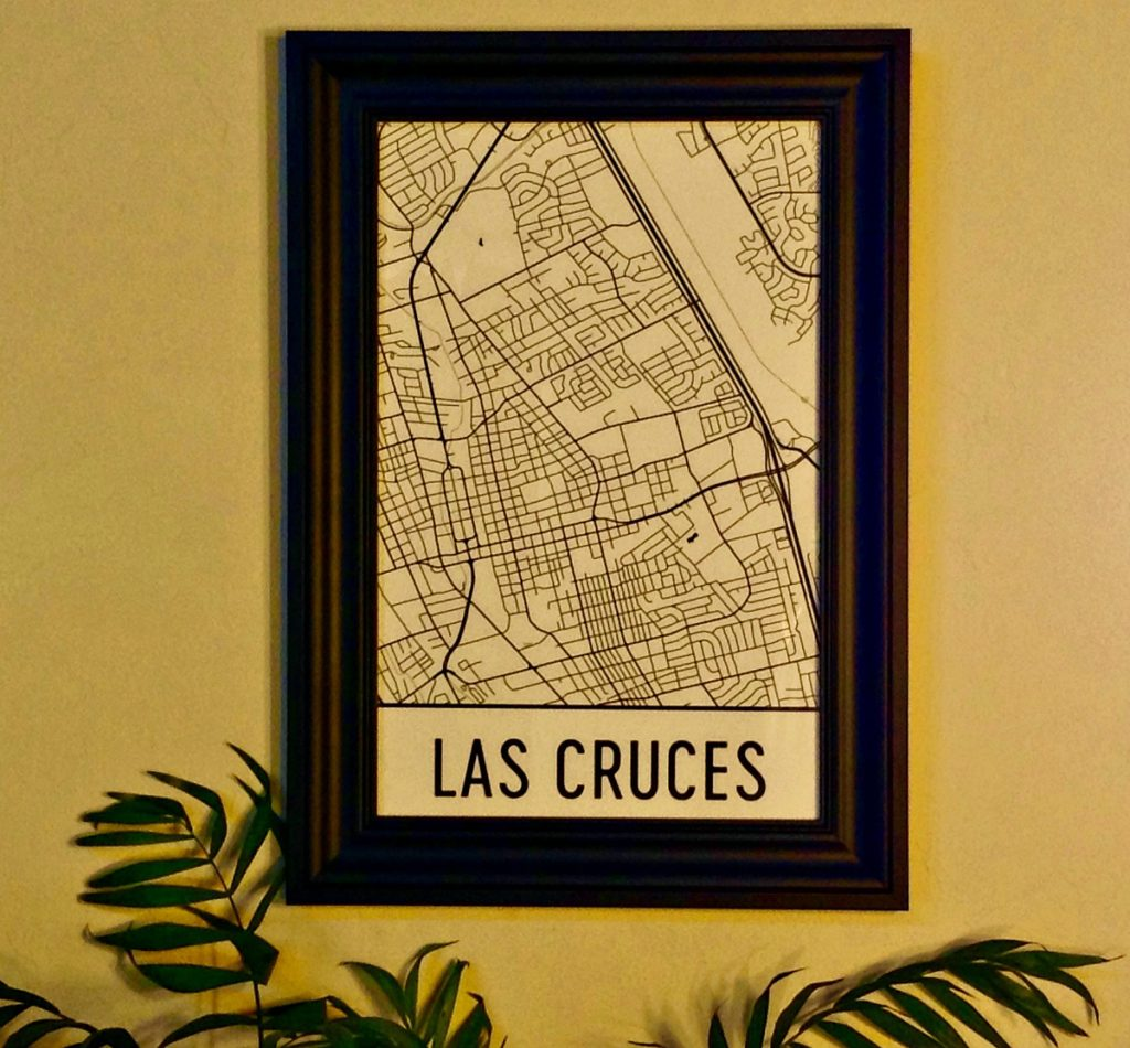 Las Cruces map by Modern Map Art in a black frame on an earth tone colored wall.