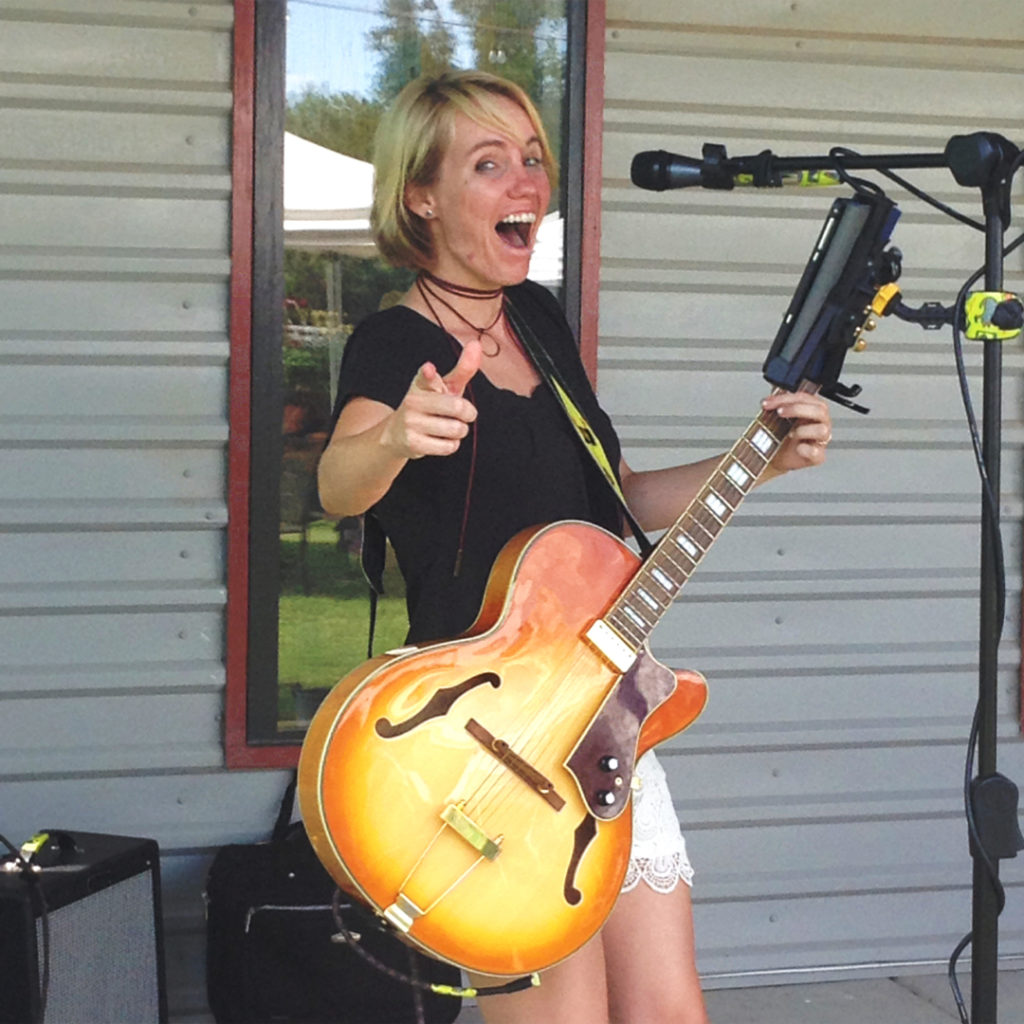 Singer-guitarist Daisy Blue winds up a song during a Sombra Antigua Winery patio party.