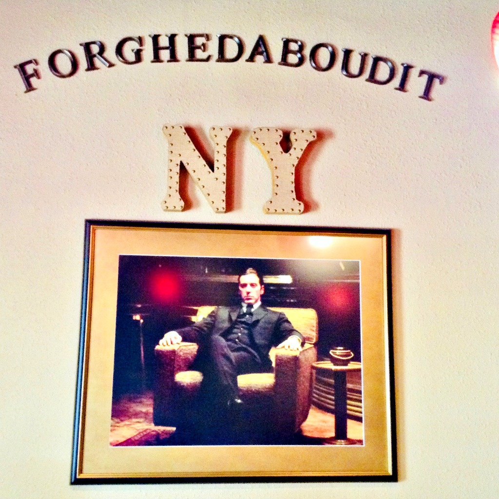 A print depicting fictional New York Italian mob boss, Michael Corleone, is one of many wall hangings at Forghedaboudit, a restaurant in Deming, New Mexico.