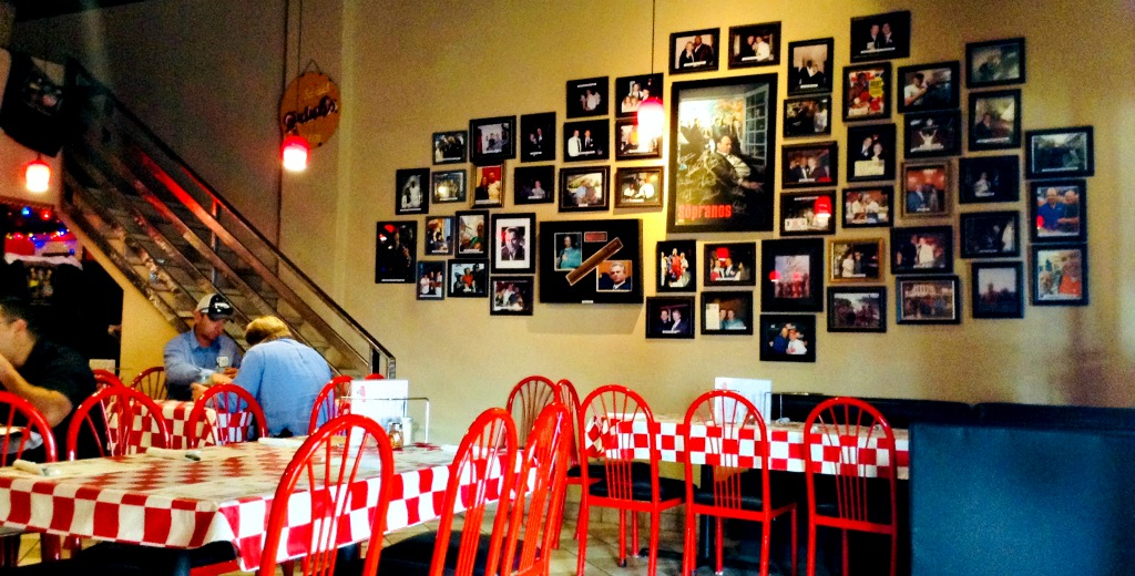 Red chairs and checkered tablecloths create a New York Italian vibe at Forghedaboudit in Deming, New Mexico.