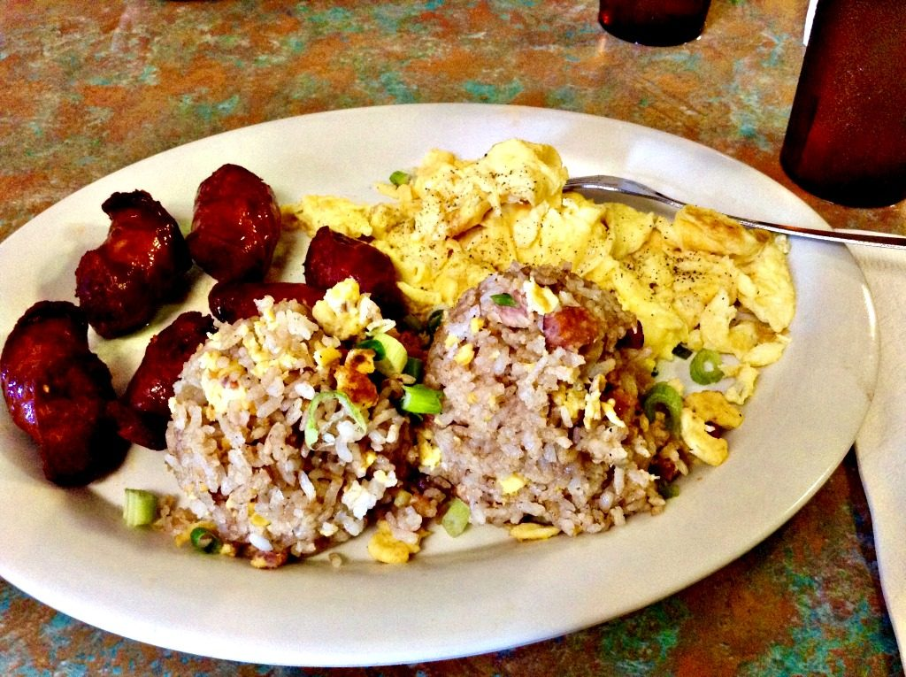 "Hawaiian-style breakfast with ""two-scoop rice,"" Portuguese sausage, and scrambled eggs."