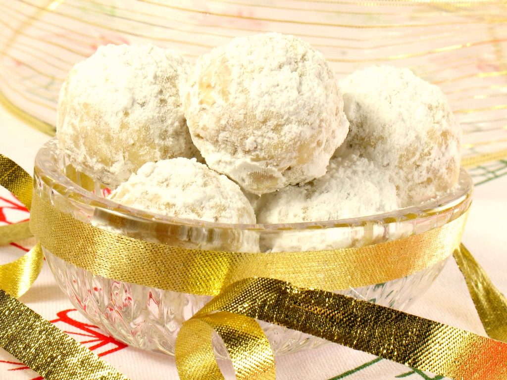 Here's a Mexican wedding cookies recipe for your next very special event. These buttery sugar-rolled confections with a crumbly texture and buttery taste are not only popular at weddings but Christmas time as well. No wonder ~ they're festive and look like snowballs. Image: Christmas Tea Cookies by Dream Big Photos