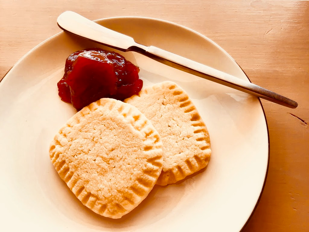 This dish with strawberry jam and shortbread cookies illustrates one of our favorite food quotes.